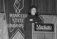 Mankato State University, woman speaks during Campus Campaign event, 1989