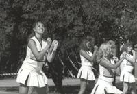 Mankato State University, cheerleaders perform on the Campus Mall during Homecoming, 1988