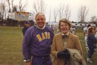 Coach Dan Runkle (L) and President Margaret Preska (R) after a Mankato State University football game.