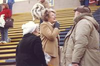 Mankato State University president Margaret Preska talking with MSU football fans after a football game.