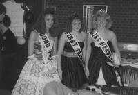 A picture of Miss Henderson and her first and second princesses participating during a 1988 Mankato State University Homecoming event.