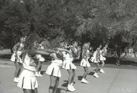 Mankato State University, cheerleaders cheer on the Campus Mall during Homecoming, 1988