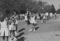Mankato State University, cheerleaders on the Campus Mall during Homecoming, 1988