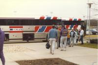 Mankato State University football fans load a charter bus after an MSU football game.