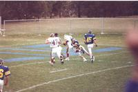 Action shot of Mankato State University football game against South Dakota State University at Blakeslee Stadium. A Mankato State University player has the ball and looks as if he is gong to score a touchdown. November 14, 1987.