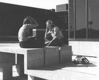 Two students talk outside of the Mankato State University Trafton Science Center, 1970s.