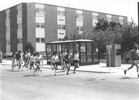 Group of people running down Maywood Avenue by Nelson Hall. Mankato State University in the late 1970's.
