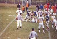 Action shot of the Mankato State University football  game against South Dakota State University at Blakeslee Stadium. November 14, 1987.