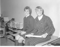 Two women working at a table in the student union book store at Mankato State College 1968-02-16
