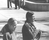 Two females walking outside of Armstrong Hall on the Campus Mall, Mankato State University in the late 1970's.