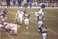 Action shot of Mankato State University football game against South Dakota State University at Blakeslee Stadium. November 14, 1987.