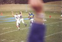 Action shot of Mankato State University football game against South Dakota State University at Blakeslee Stadium. Mankato State University player holding up his hands like they are about to score a touchdown. November 14, 1987.