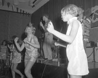 A picture of go-go dancers and SAE singers performing during the 1968 Mankato State College Charity Carnival.