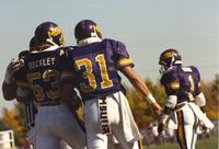 Mankato State University, players standing on the field at the MSU vs. SDSU football game on September 30, 1989 at Blakeslee Stadium.