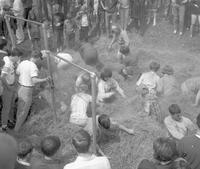 College students in straw during the Greek Week pig chase at Mankato State College 1966-05-25