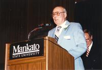 Floyd Kelley speaking at retirement banquet located in the Centennial Student Union. Mankato State University, June 1, 1989.