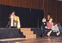 Previous king court with unidentified individuals waiting to announce the new king and queen in the Centennial Student Union Ballroom, Mankato State University