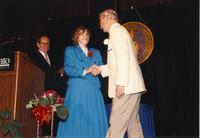 Vic Colway shaking hands with Margaret Preska at retirement banquet located in the Centennial Student Union. Mankato State University, June 1, 1989.