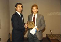 Male athlete receiving an award at Athletic Academic Awards Banquet held in the Centennial Student Union. Mankato State University, June 1, 1989.