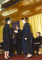 Margaret R. Preska (R) shaking a students hand at commencement, Mankato State University