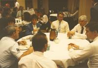 A group of unidentified men and women eating dinner at Career Week in the Centennial Student Union Ballroom, Mankato State University