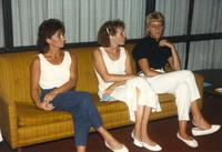 Three women sitting on a couch at Donna Evans retirement. Mankato State University, August 03, 1989.