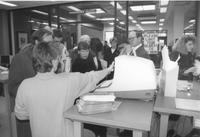 A group of unidentified faculty and students by the online catalog in the Memorial Library, Mankato State University