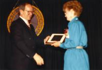 Mary Smidt receiving an award at the retirement banquet located in the Centennial Student Union. Mankato State University, June 1, 1989.