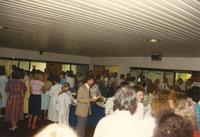 People socializing at Donna Evans retirement. Mankato State University, August 03, 1989.
