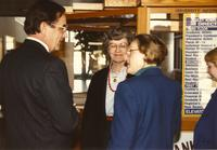 Former Minnesota governor Rudy Perpich (L) talking to Mary Dooley (M) and Margaret R. Preska (R), who is looking at him, by the University Information, Mankato State University