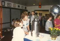 People getting food and talking at Donna Evans Retirement. Mankato State University, August 3,1989.