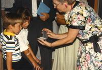 Donna Evans Retirement, Donna receiving a gift. Mankato Stare University, August 3, 1989.