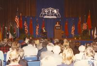 An unidentified woman giving a speech to a crowd in the Centennial Student Union Ballroom, Mankato State University
