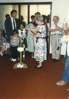 Donna Evans receiving a gift at her retirement. Mankato State University, August 03,1989.