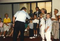 Donna Evans Retirement, receiving gifts. Mankato State University. August 03, 1989.