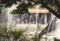 Picture of the entrance of Memorial Library through the fountain. Mankato State University, May 29, 1989.