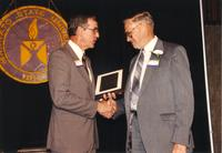 Winston Benson receiving an award at the Retirement Banquet located in the Centennial Student Union. Mankato State University, June 1, 1989.