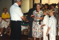 Donna Evans Retirement, receiving gifts. Mankato State University. August 3, 1989.