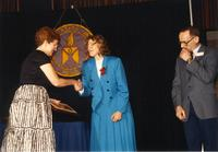 Female shaking hands with Margaret Preska at retirement banquet located in the Centennial Student Union. Mankato State University, June 1, 1989.