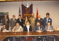 Margaret R. Preska seated in the middle with a group of unidentified individuals in the Centennial Student Union, Mankato State University