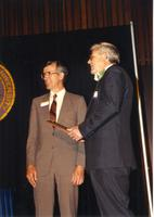 Male receiving an award at the retirement banquet located in the Centennial Student Union. Mankato State University, June 1, 1989.