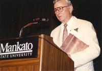 Vic Colway speaking at retirement banquet located in Centennial Student Union. Mankato State University, June 1, 1989.