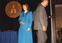 Dean Turner and Margaret Preska standing on stage at retirement banquet located in the Centennial Student Union. Mankato State University, June 1, 1989.