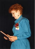 Mary Smidt looking at the award she got at the retirement banquet located in the Centennial Student Union. Mankato State University, June 1, 1989.