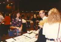 Unknown staff at Career Week and students browsing around in the Centennial Student Union Ballroom, Mankato State University
