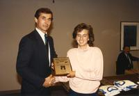 Female athlete receiving an award at Athletic Academic Awards Banquet held in the Centennial Student Union. Mankato State University, June 1, 1989.