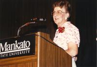 Female speaking at the retirement banquet located in the Centennial Student Union. Mankato State University, June 1, 1989.