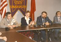 Margaret R. Preska sitting at a desk with 3 unidentified men, Mankato State University