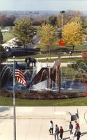 Group walking by The Fountain, Campus Mall, Fall, Mid-Late 1980's, Mankato State University
