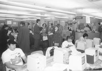 A group of unidentified faculty and students in the Memorial Library, Mankato State University